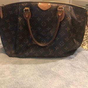 Authentic rare LV tapered bag.